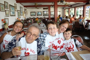 Nana and Jido with some of the grandkids.  Moxie made the bibs at her store...