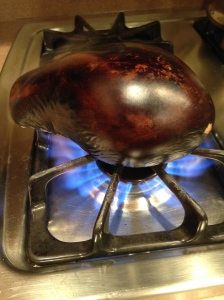 Charring the eggplant, I will add chopped onions and lemon juice.